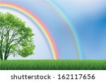Double Rainbow over green field with tree