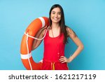 Small photo of Lifeguard woman over isolated blue background with lifeguard equipment and with happy expression