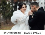 bride and groom posing. the... | Shutterstock . vector #1621319623