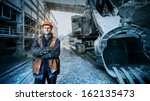 worker in a helmet stands near... | Shutterstock . vector #162135473