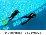 two divers are trained in the... | Shutterstock . vector #162198026