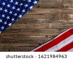 usa flag lying on an old wooden ... | Shutterstock . vector #1621984963