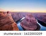 A Male Hiker Is Standing On Top ...