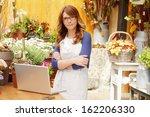 smiling mature woman florist... | Shutterstock . vector #162206330