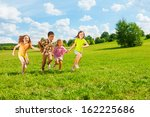 kids running in the park... | Shutterstock . vector #162225686