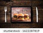 an hamburger with lettuce ...