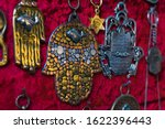 Small photo of Hamsa hand, also known as Fatima Hand or Hand of God necklace, pending on a market in Tel Aviv-Jaffa, Israel. Metal protection amulet.