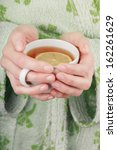 cup of tea with lemon in woman... | Shutterstock . vector #162261629