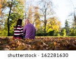 romantic couple in a park | Shutterstock . vector #162281630