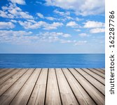 Empty Wooden Pier With Sea And...