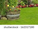 Flower Garden. A Barrel...