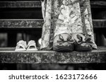 Small photo of photo shoot pregnancy, slippers, mother and baby, black and white, maternal love.
