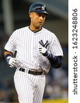 Small photo of BRONX, NY - APR 16: New York Yankees shortstop Derek Jeter (2) rounds the bases after hitting a solo homerun during the first inning against the Minnesota Twins on April 16, 2012 at Yankee Stadium.