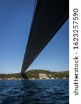 Small photo of Istanbul Bosphorus and Bosphorus bridge from under the bridge under the blue sky on a sunny day.