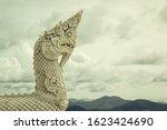 A Serpentine Dragons Head At...