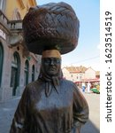 """Small photo of Zagreb / Croatia - July 12, 2016: """"Kumica Barica"""" statue at Dolac market. Zagreb decided to pay tribute to hard working farm women, locally called """"Kumica""""."""