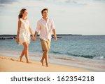 romantic happy couple walking... | Shutterstock . vector #162354218