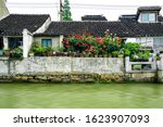 White walls and black tiles of a family in Suzhou, Jiangsu Province, China .White wall and Black tile, Shantang street, Suzhou, Jiangsu Province, China. Small bridges and flowing houses in South China
