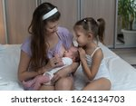 mother with eldest daughter... | Shutterstock . vector #1624134703