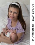 mother with a newborn baby... | Shutterstock . vector #1624134706