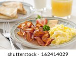 closeup of a breakfast table... | Shutterstock . vector #162414029