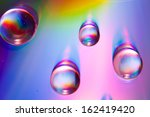 water drops on colorful... | Shutterstock . vector #162419420