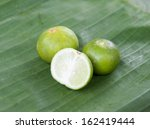 lime of thailand on green background - stock photo