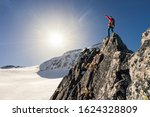 Climber Or Alpinist At The Top...