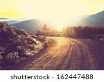 Stock photo road in forest 162447488