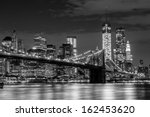 Brooklyn Bridge And Manhattan...