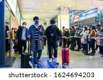 Small photo of Chengdu, Sichuan / China - January 23 2019: travellers all wear mask at airport to prevent infection from coronavirus. The virus has caused emergency situation during Chinese New Year.
