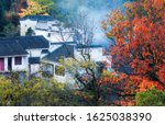 Ancient buildings in the mountains, reflecting the red leaves in autumn, Chizhou City, Anhui Province, China.