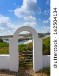 Small photo of Menorca Cala Sa Mesquida Mao Maon arch entrance in Balearic islands