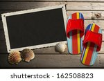 photo frame on wooden boardwalk ... | Shutterstock . vector #162508823