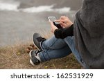 mobile phone on human hand by...   Shutterstock . vector #162531929