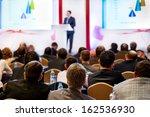 speaker on the podium. people... | Shutterstock . vector #162536930