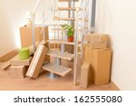 stack of cartons near stairs ... | Shutterstock . vector #162555080