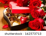 heart shaped box of chocolate... | Shutterstock . vector #162573713