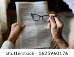 Newspapers And Glasses In The...