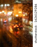 Rain On Window With Traffic On...