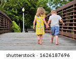 Young Boy And Girl Holding...