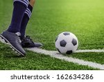 kick off soccer ball with his... | Shutterstock . vector #162634286