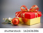 christmas gift box on background | Shutterstock . vector #162636386