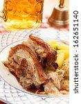 pork with potatoes and beer   Shutterstock . vector #162651140