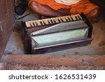 An Old Man Playing Harmonium At ...