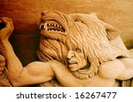 Sand sculpture representing American indians - stock photo