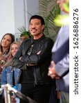 Small photo of LOS ANGELES - JAN 23: Lionel Richie at the Sir Lucian Grange Star Ceremony on the Hollywood Walk of Fame on JANUARY 23, 2019 in Los Angeles, CA
