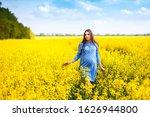 a beautiful pregnant girl walks ...   Shutterstock . vector #1626944800