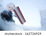 winter driving   scraping ice... | Shutterstock . vector #162726929