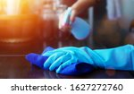 Hand in blue rubber glove...
